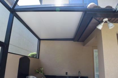 Insulated panel roof over outdoor kitchen