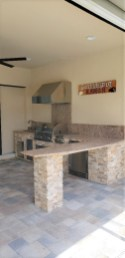 L Shape outdoor kitchen with Trade Wind hood