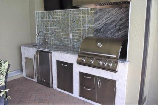 summer kitchen with tile backsplash