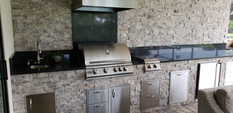 Silver Travertine Stacked Stone Combined with Level 3 Black Jet Granite Finish on a Custom Outdoor Kitchen