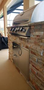 Close-up of Golden White Stacked Stone and Blaze Combo Stainless Steel Storage Unit