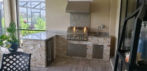 Custom Outdoor Kitchen - Barbecue Island Finished with Leonardo Stacked Stone and Level 3 Gorgeous Fontana Granite