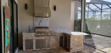 36 Inch Crystalo Granite Backsplash directly behind the grill leading up to a 36 Inch Tradewind Hood