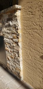 Close-up of Cappadocia Stacked Stone Outdoor Kitchen - Elegant Outdoor Kitchens of SWFL