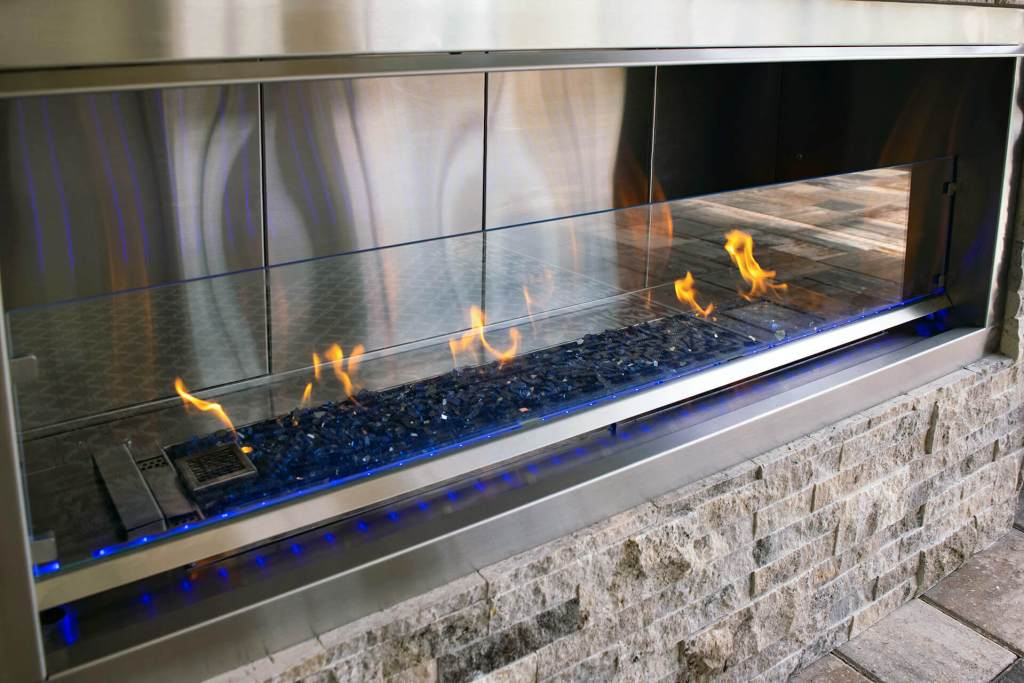 Close-up of Custom Designed and Constructed Outdoor Fireplace Project - Elegant Outdoor Kitchens Custom