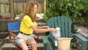 A mother practicing How to clean oxidized plastic patio chairs