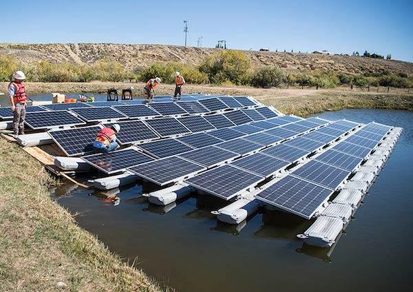Photo: Floating PV array under construction in Colorado, via NREL.