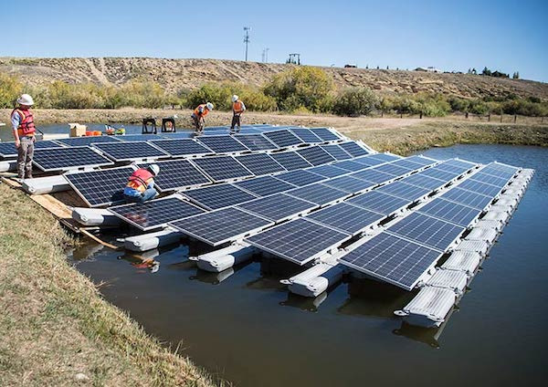 Photo: Floating PV array under construction in Colorado, via NREL.