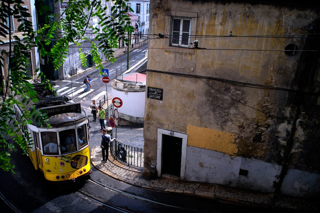 One of Lisbon's many trams makes it's way through the Old Quarter.