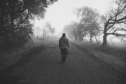 Boy Walking Down Misty Country Road 1400