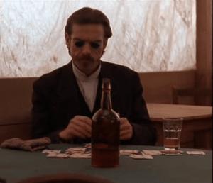 Dennis Quaid as Doc Holliday sporting his gambling shades.