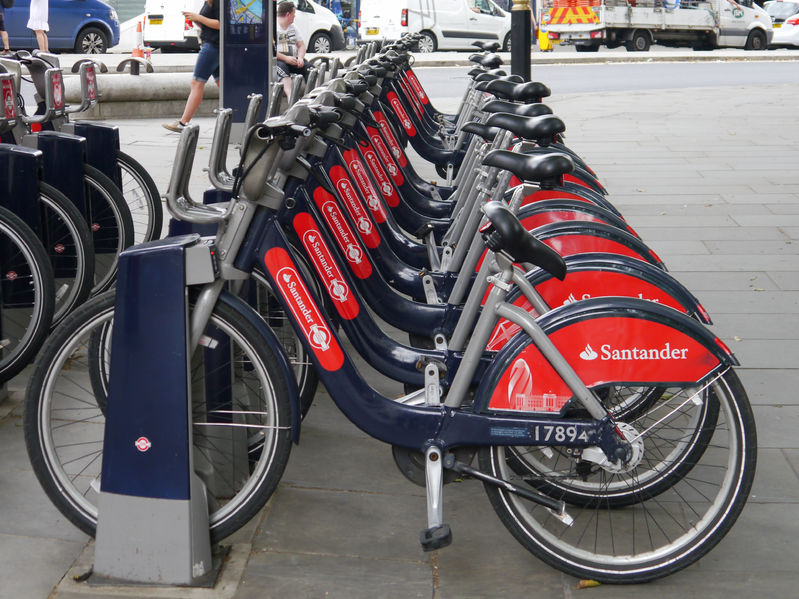 77361965 - london red rental hire bikes with the sponsor livery of santander london uk