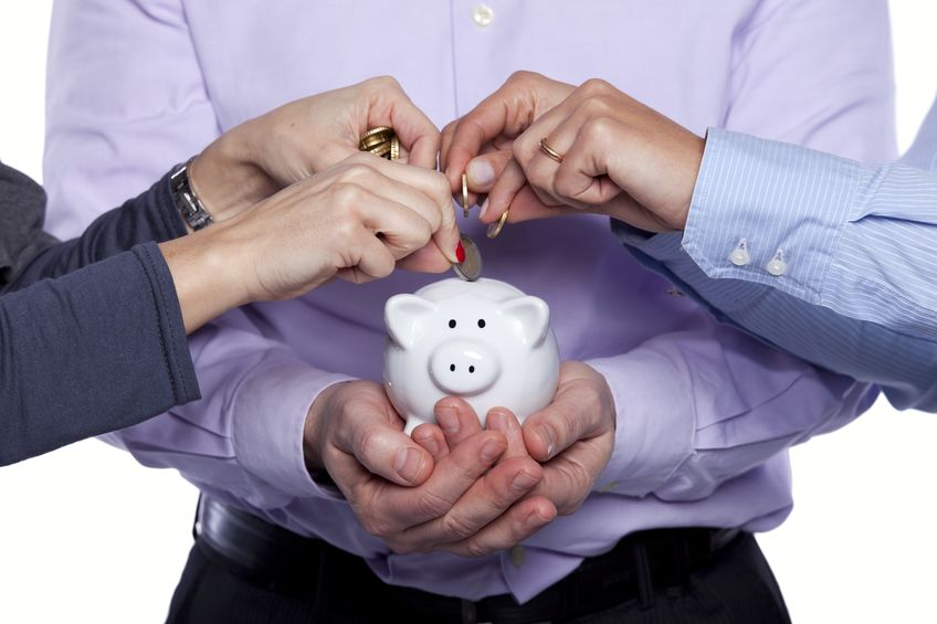 10030561 - group of business people saving money on the piggybank