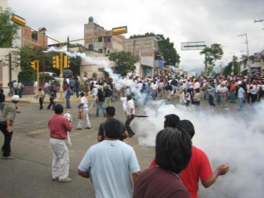 People Throwing Tear Gas Back