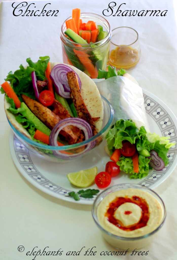 Shawarma is an wrap with flat bread , meat,fresh veggies,tahini ,hummus etc.A world favorite fast food  from the Arabic cuisine.