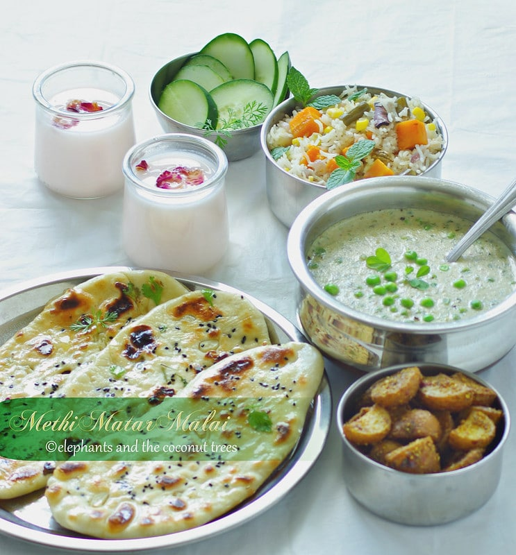 Homemade butter naan, Spicy Potato Fried, Methi matar Malai, Vegetable Pulao (Rice) , Cucumber sliced and  Rose Lassi.