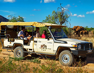 Elephant Watch Camp, game drives, land cruiser, safari vehicle, giraffe, Big Five animals, wild safaris, wildlife safaris, conservation, Samburu National Reserve, Elephant Watch Portfolio, Nairobi, Kenya