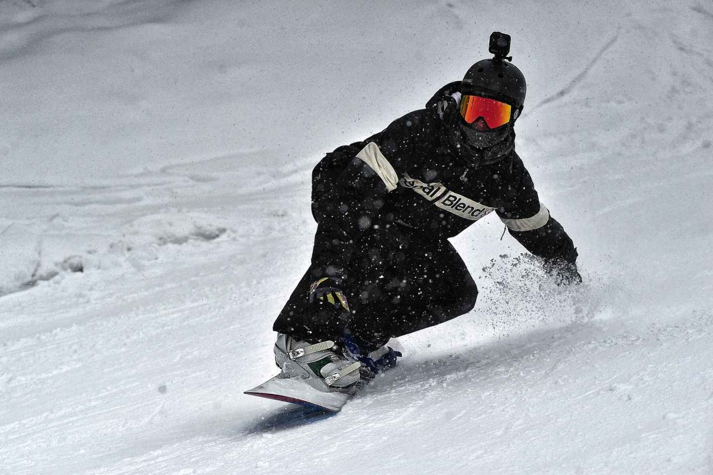 Snowboarder with ski goggles