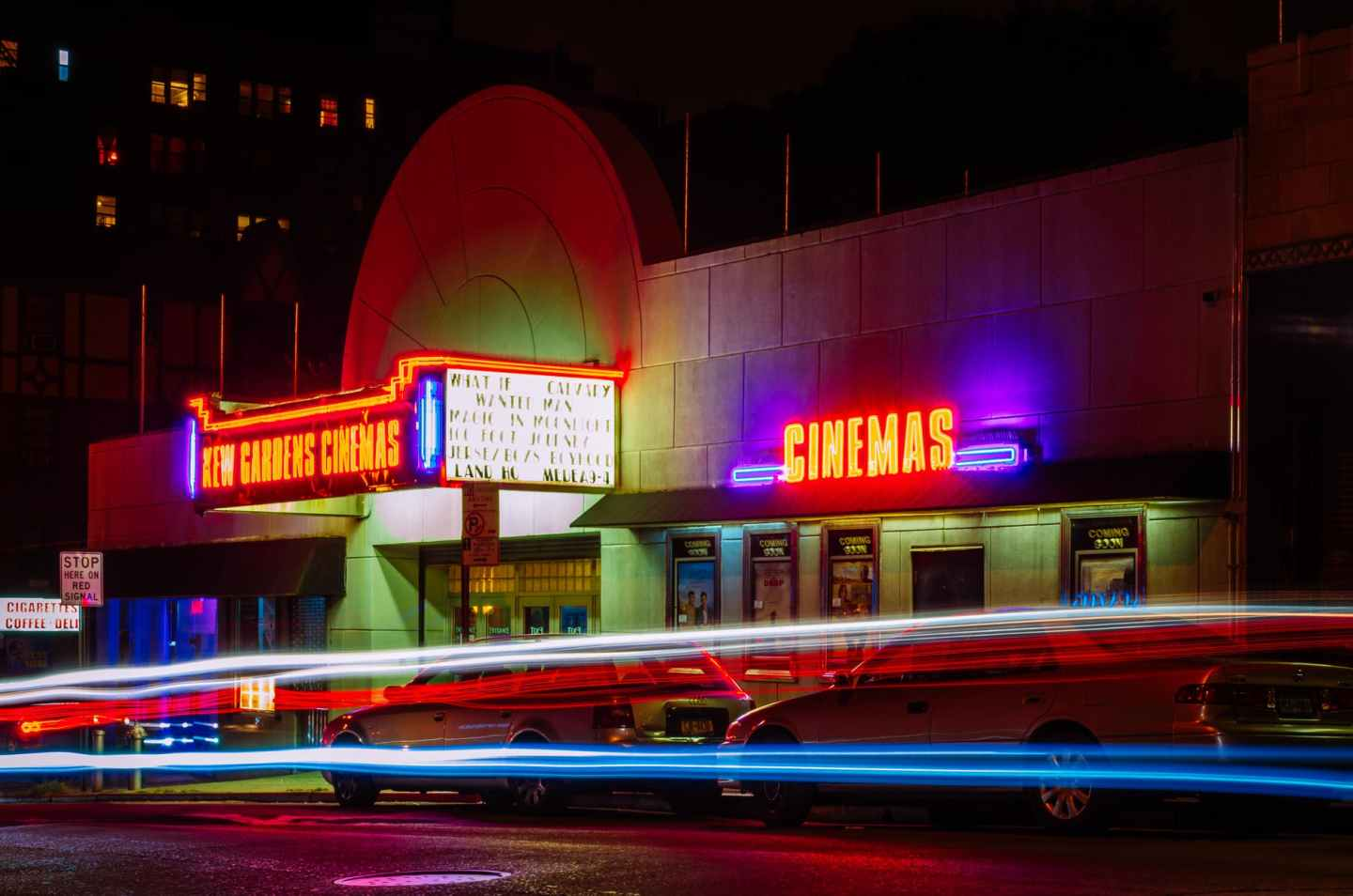 Exterior of cinema with neon lights - the movie business is rapidly pivoting
