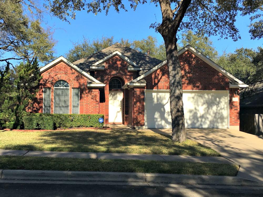southwest austin neighborhoods lowest property tax rate best schools village western oaks