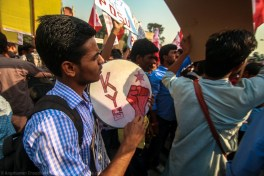 These circular hand-held drums (called 'daphli') are a staple to most student demonstrations and rally. They are often the representative blow-horns for individual organisations participating in the protests or rallies. This particular one speaks of a student youth party active in the Delhi University circuit - Krantikari Yuva Sangathan (Revolutionary Youth Organisation).