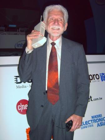 Martin Cooper with world first hand held mobile phone