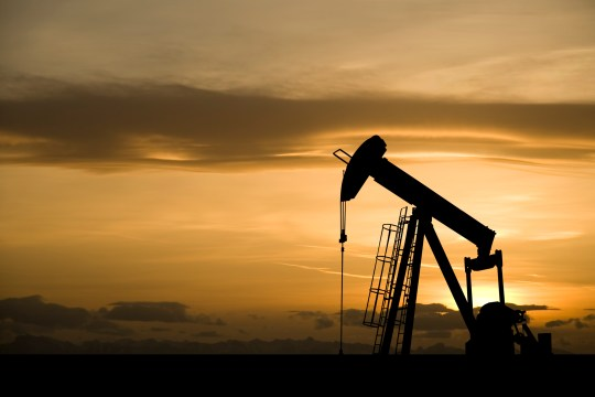 Silhouette of pumpjack in Canada at sunset