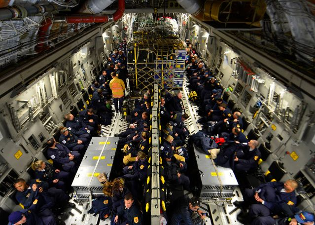US Rescue team w 70,000 pounds of supplies