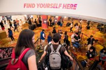 "BBYO members enter convention to see the movement's slogan ""Find Yourself Here."""