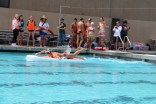Junior boy Cooper Powell swims across the pool.