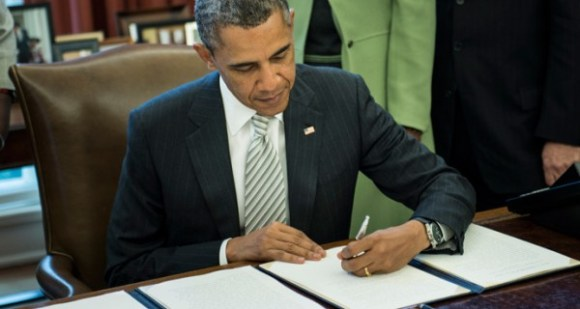 obama-signs-monsanto-act.si_1-600x320