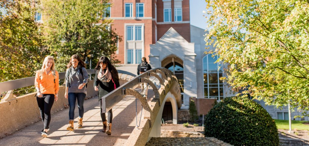 UT Students walking across pedestrian bridge
