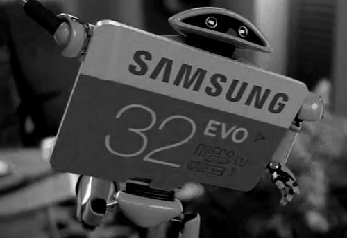 android robot and an SD card in black and white picture