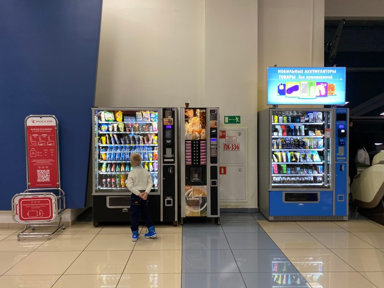 A kid and vending machines in Russian airport.