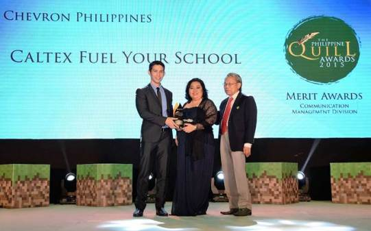 Receiving the Philippine Quill merit award trophy are from left; Joel Gaviola assistant manager Policy, Government and Public Affairs (PGPA) of Chevron Philippines, Inc. (CPI), Cherry Ramos coordinator PGPA CPI, and Jun Salipsip executive director American Chamber Foundation, Inc.