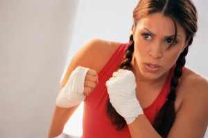 Woman Exercising with Punching Bag