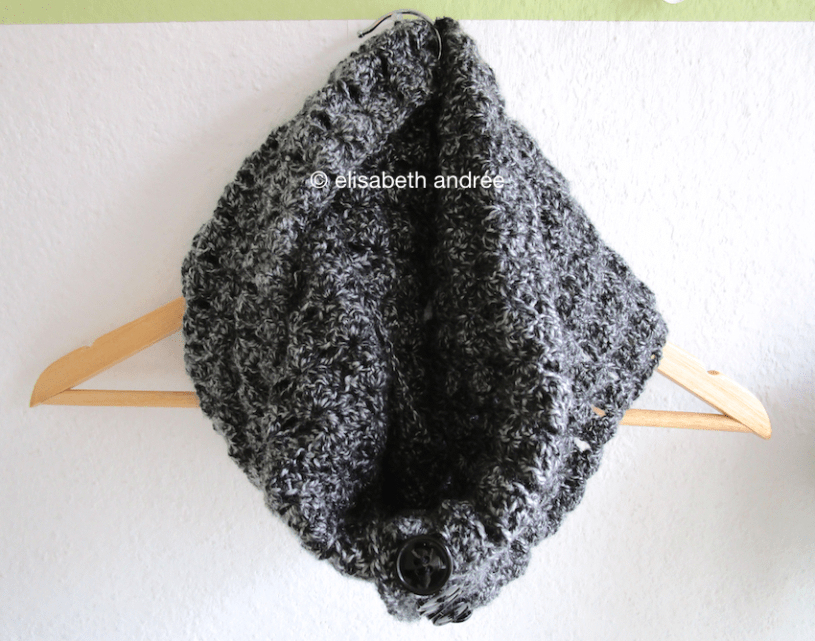 crochet charcoal cowl on hanger by elisabeth andrée