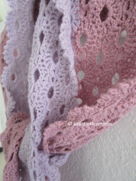 close up of crochet lace stole scarf lilac and pink