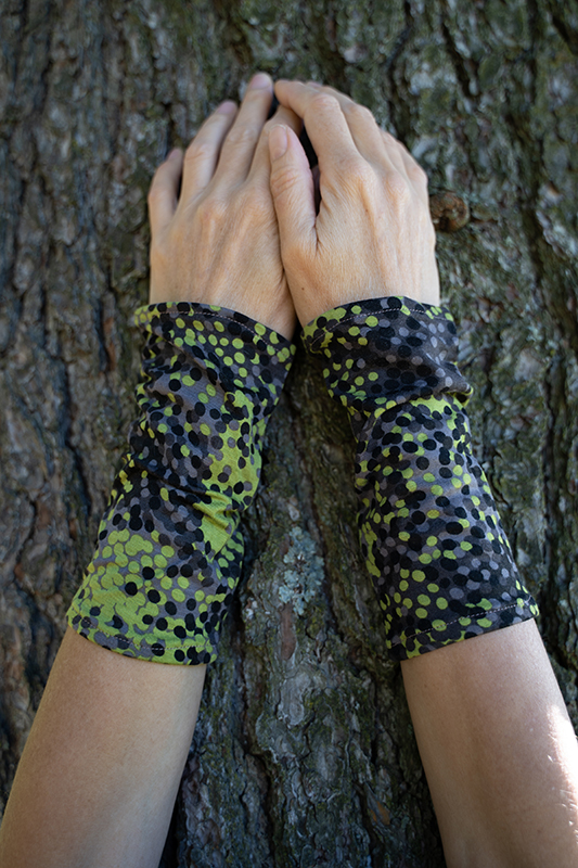 Wrist warmers in grey, green, and black