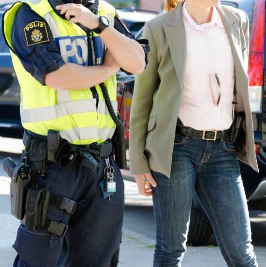 Polis i arbete Copyright: Dreamstime.com