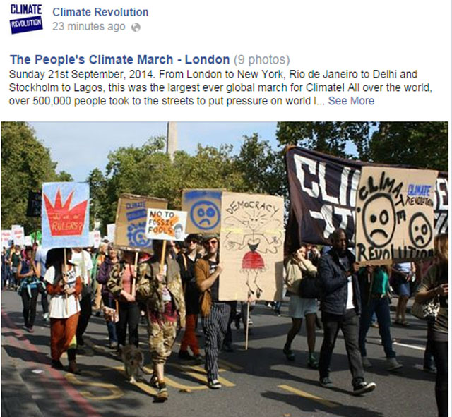 "Photo People's Climate March: Parade with signs in London. ""Climate Revolution"" and No to Fossil Fools.."