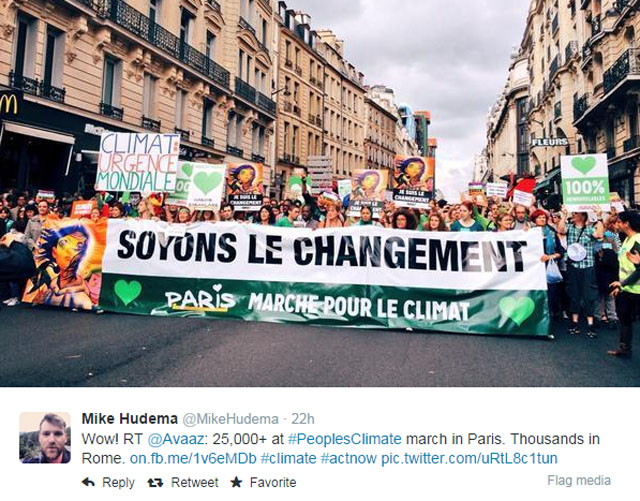 "Photo People's Climate March: Paris. People holding big sign ""Soyons le Changement"" (Let's be the change)."