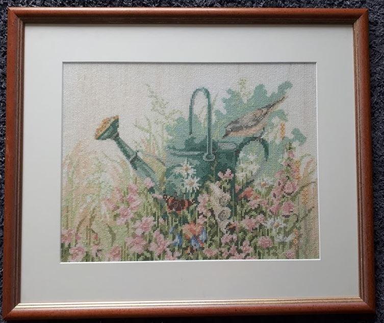 gieter en vogel borduurwerk