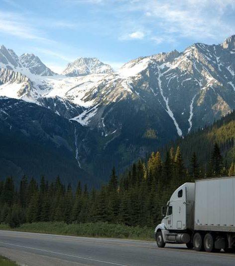 Online CDL training graduate driving truck.