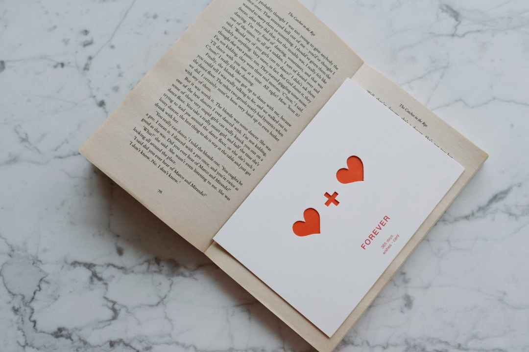 opened book with valentine lying inside
