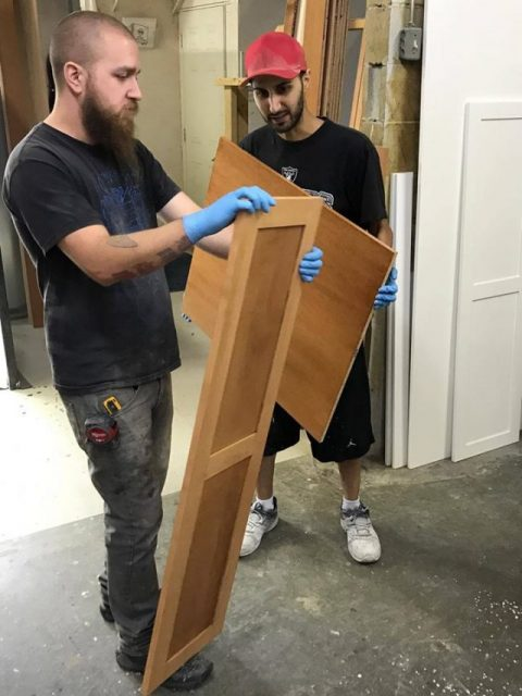 Shop workers building custom cabinets
