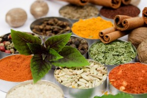 Basil leafs over assortment of spices