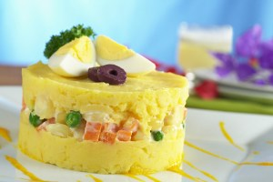 Traditional Peruvian dish called Causa made of mashed potato and vegetables