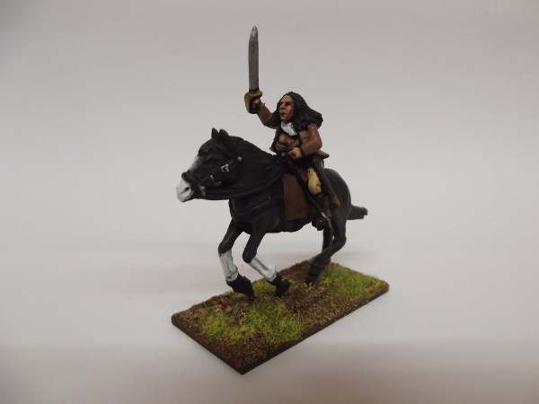 Spanish Guerilla with horse holding sword