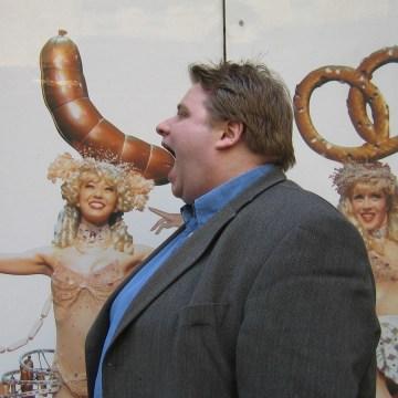 Daniel noshing on huge German sausage